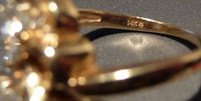form Gold & Diamond Ring with asterisk markingwhat does it mean