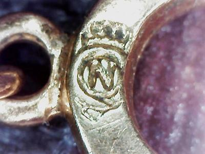 gold chain with n in a circle mark On a in a circle jewelry mark