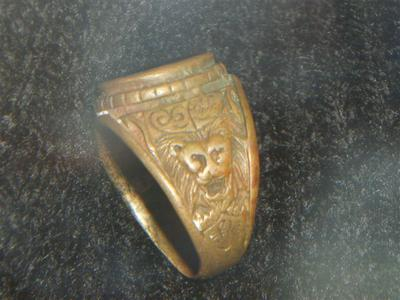 The ring shows red colour so could be bronze and other metal maybe