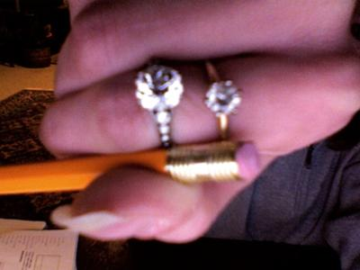 the ring on top is my one carat diamond ring below it is my grea great aunts 3 ct. ring