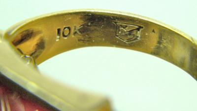 R/S within a shield, stamped in older Masonic ring