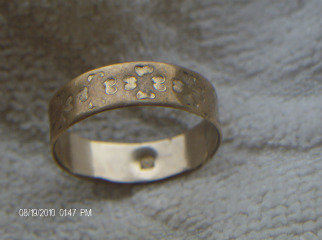 X marks on gold rings