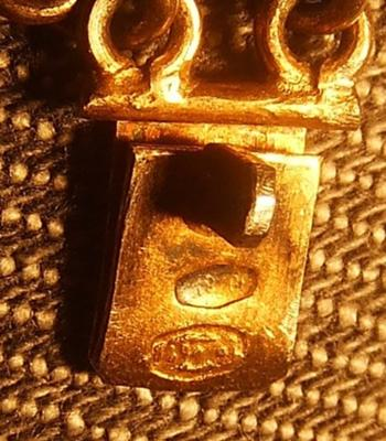 Markings on clasp