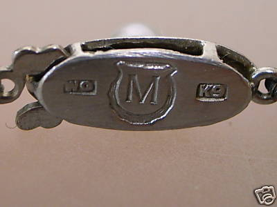 hallmarks on reverse of white gold clasp