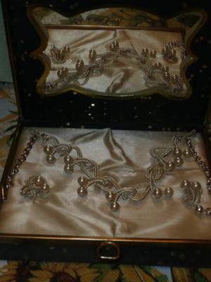 the necklace and earrings inside of box on display where there also is a mirror