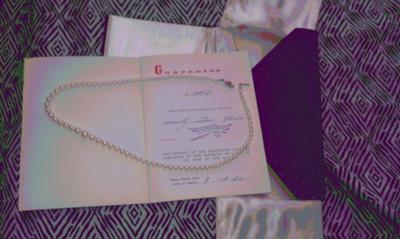 this is just a picture of the little book and of the whole necklace the pearls came with